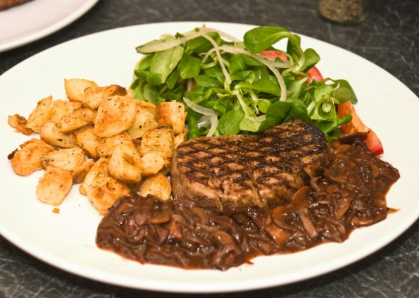 Anna's fillet steak with red wine, onion and mushroom sauce, lambs lettuce salad and miniature weapons grade roast potatoes